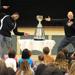 Marco Iannuzzi with Rolly Lumbala touring the Grey Cup to local schools
