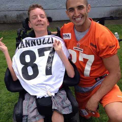 Marco Iannuzzi giving signed jersey to lifetime BC Lions supporter and friend Brenden Parker