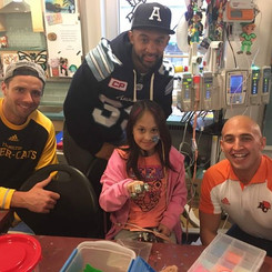 Marco Iannuzzi with Andy Fantuz and Matt Black visiting Toronto's Children's Hospital during 104th Grey Cup