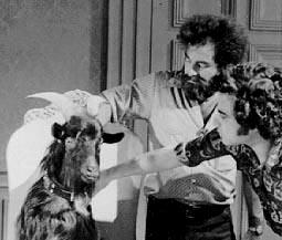 """Assistant director Brad Aronson and director Jeannot Szwarc coach a goat for """"The Return of the Sorcerer"""""""