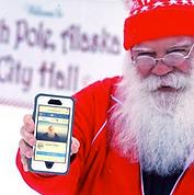 Santa Facebook Holding Cellphone Eric En