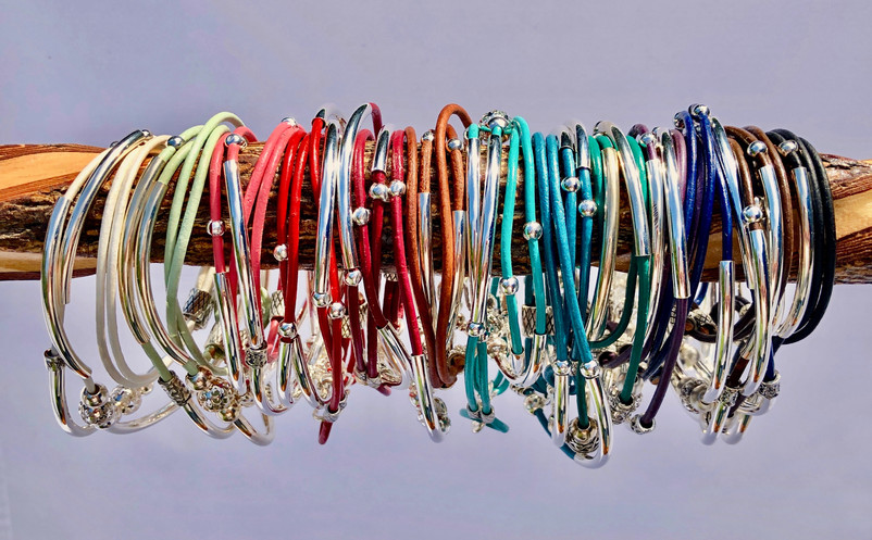 A rainbow of leather and silver bracelets