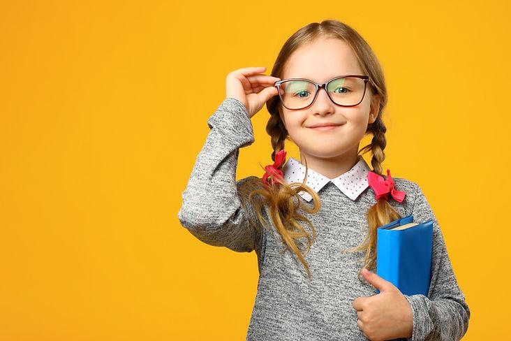 Portrait of a cute little kid girl on a
