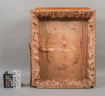 Damaged shadowbox for feather wreath conservation