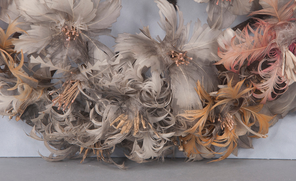 damaged feather wreath undergoing conservation treatment