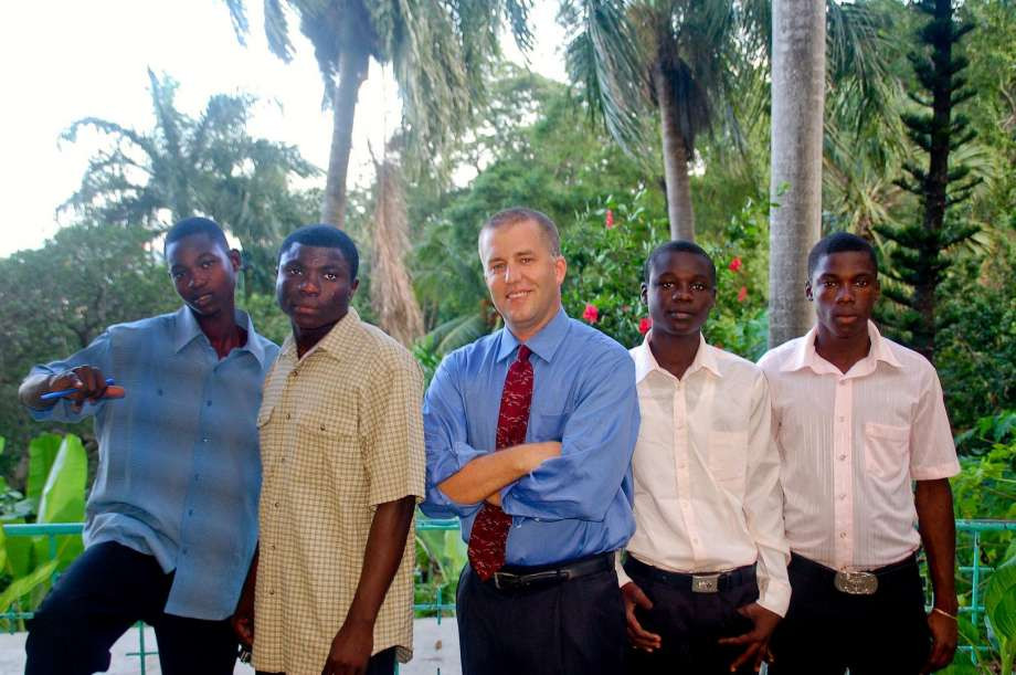 "Photo: Contributed Photo, CP - Douglas Perlitz, center, in Haiti, at the ""Village"" with some of the boys from the Project Pierre Toussaint, a program in Cap-Haitien designed to give a future to boys with none."