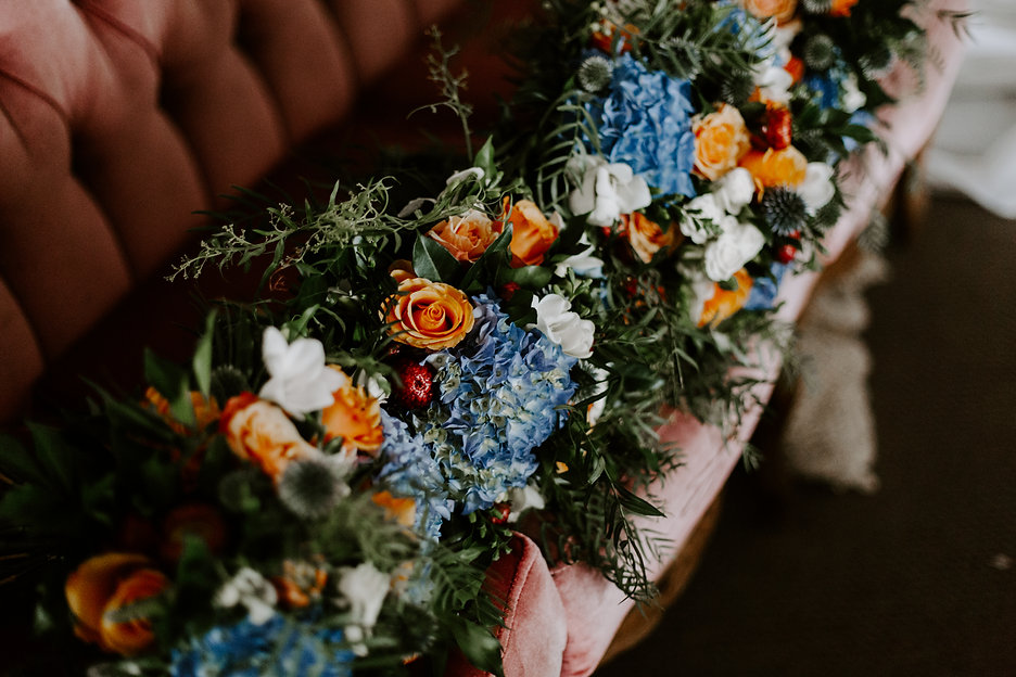 Wedding bouquets on pink couch