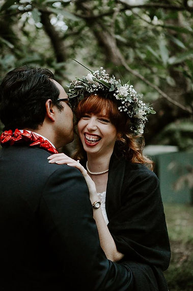 Bride smiling at wedding wearing flower crown