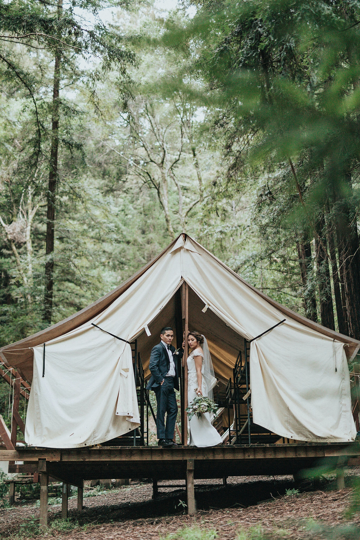 wedding couple bride groom glamping outdoors woods