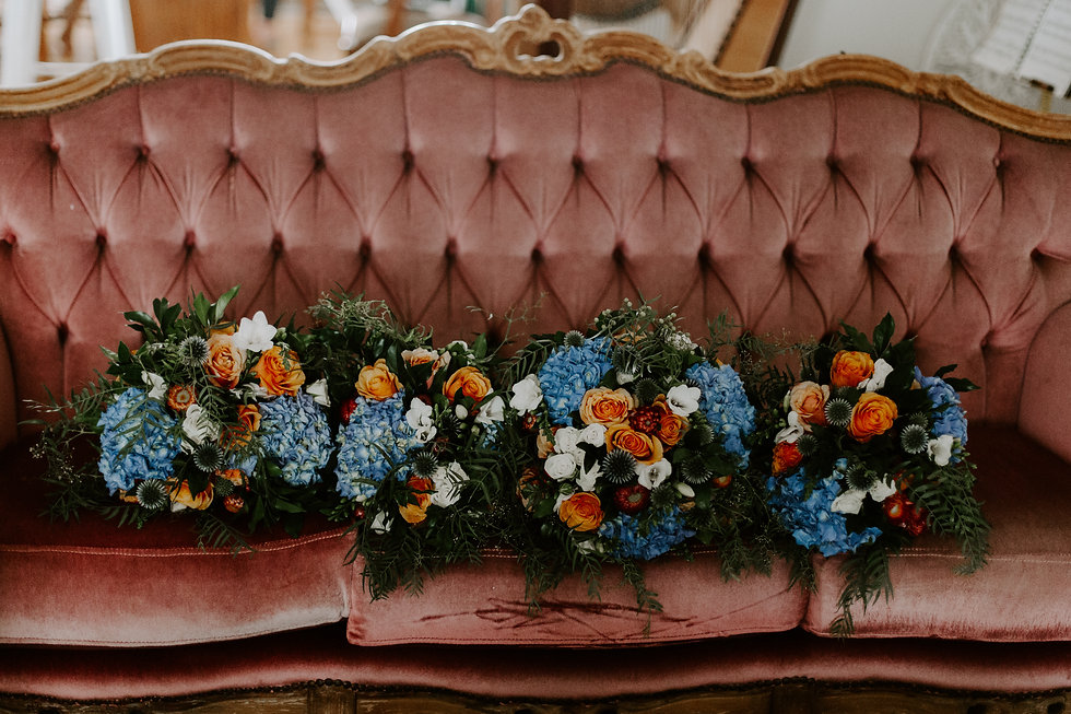 Orange blue wedding bouquets on couch