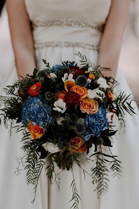 Orange blue white red white wedding bouquet
