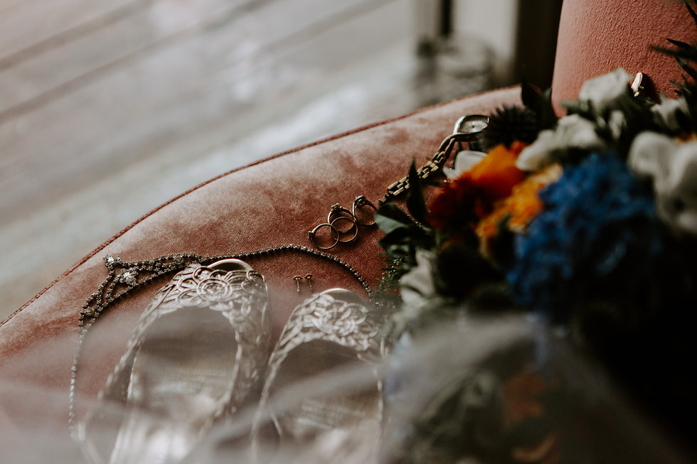 Bride accesories and bouquet on pink chair