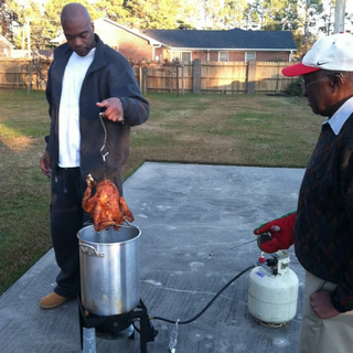 My hubby and dad frying a turkey for the 1st time.
