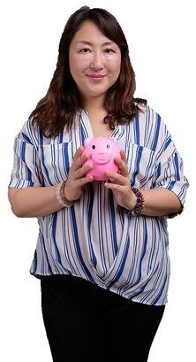 Asian Girl holds Piggy Bank .jpg