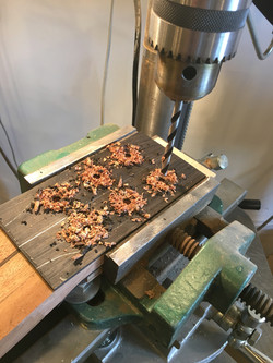 Drilling holes in peg heads