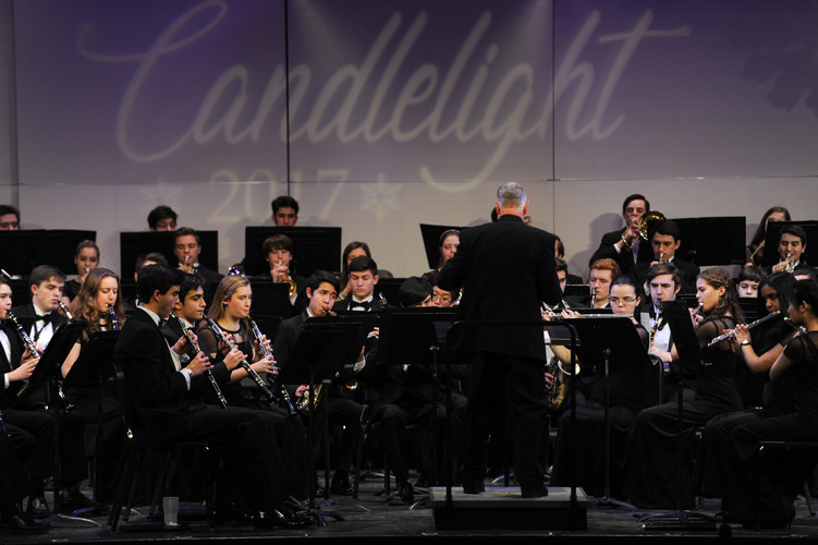 Band members perform at Candlelight 2017