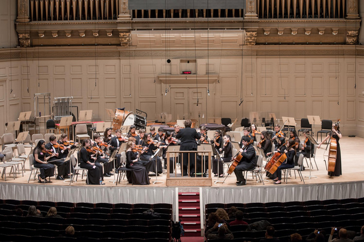 Orchestra members on stage in Boston 2016