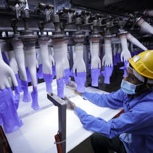 These gloves help fight COVID-19. But they're made in sweatshop conditions