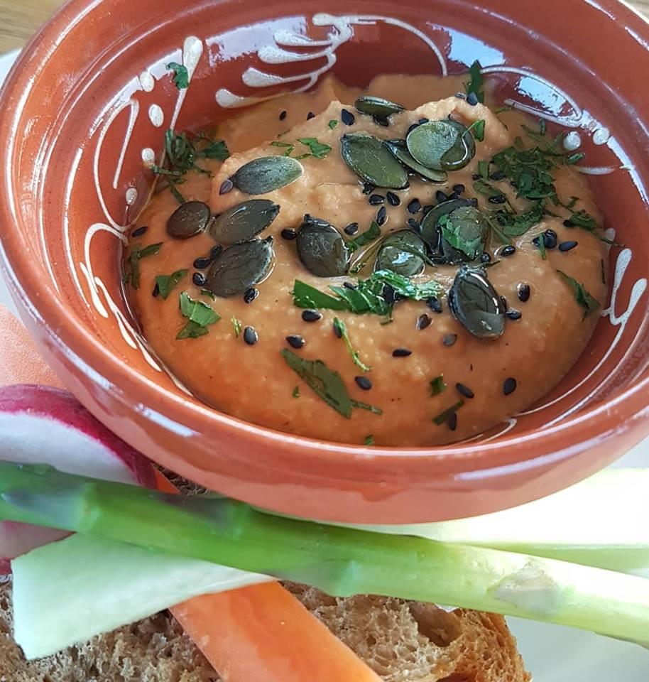 Hummus with black sesame and pumpkin seeds