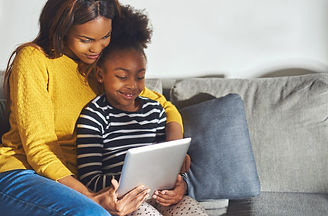 black-mom-and-daughter-looking-at-tablet.jpg