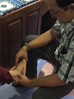 WHA Myanmar 2019 Ortho doc foot exam.jpg