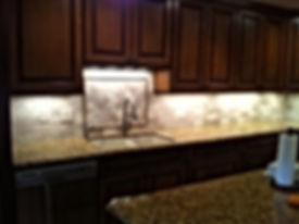 St.Cecilia Granite with 3x6 Bottacino Tumbled Marble splash