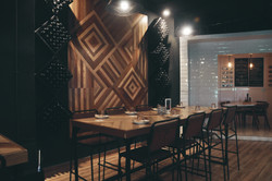 reclaimed feature wall and table at Symphony Restaurant