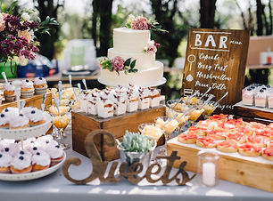 Candy bar. White wedding cake decorated