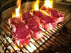 Grilling_Steaks_(with_border).jpg