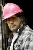 4536375-a-worker-wearing-a-pink-hardhat-and-yellow-safety-glasses.jpg