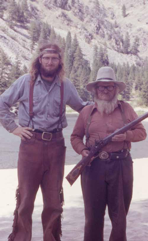 Foghat roadie gently carressing Bill's back in July 1978