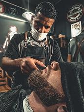 a-barber-grooming-a-man-s-beard-2881253.