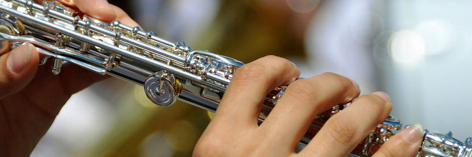 hands-playing-flute-1280x427.jpg