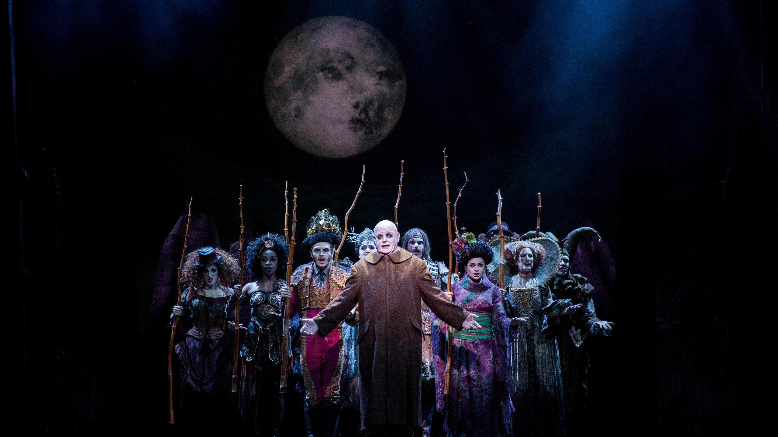 Les Dennis as Uncle Fester (centre) and the cast of THE ADDAMS FAMILY. Credit Matt Martin