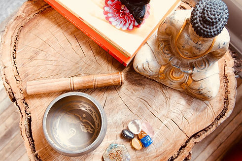 Buddha statue, crystals and Tibetan singing bowl