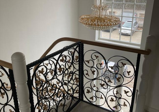 Stairs with custom blacksmith railings.