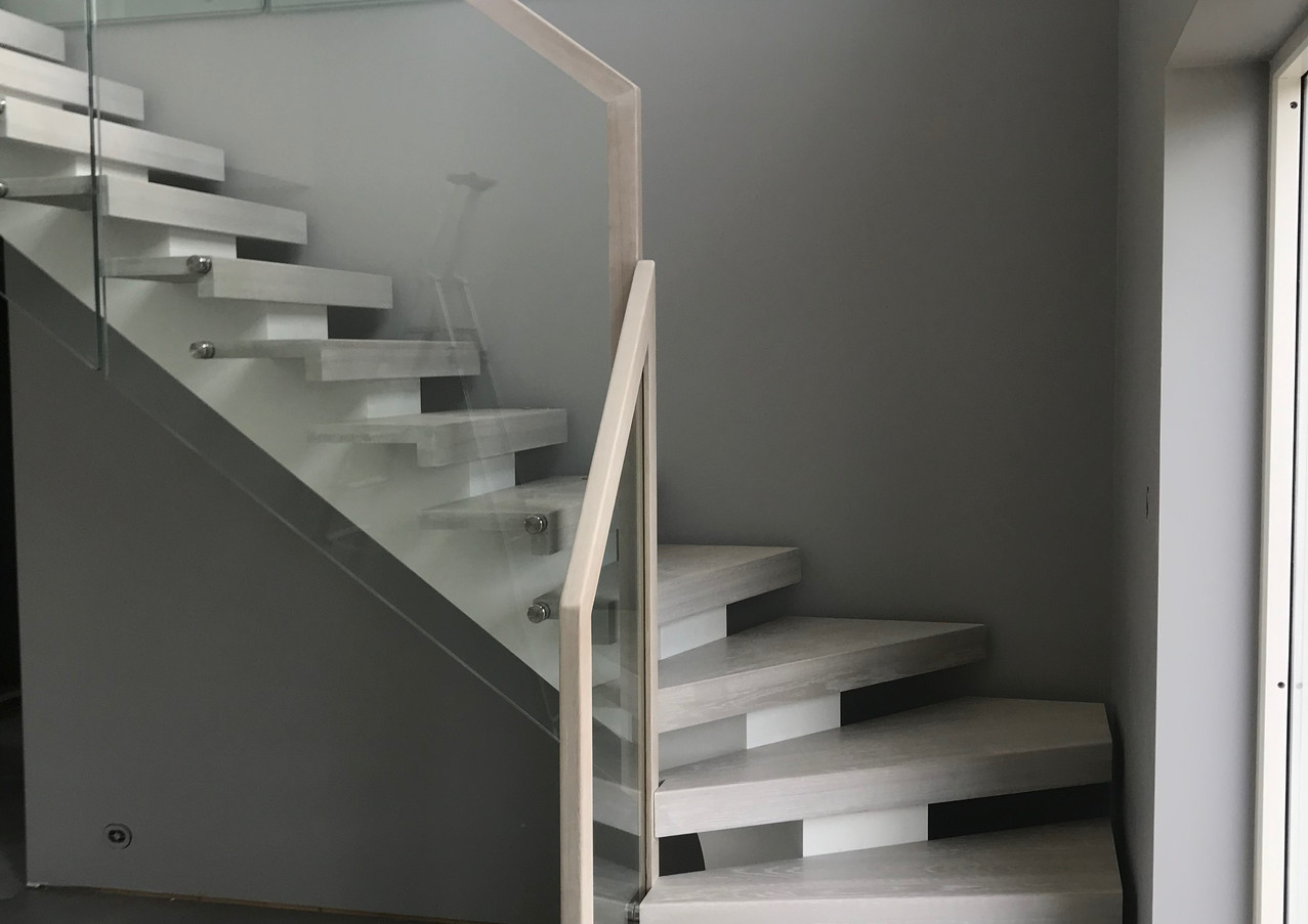 White steel construction, bright steps and glass railings.