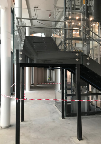 Solid construction staircase at Mercedes car showroom.