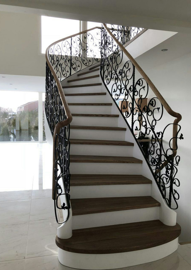 Solid construction staircase with blacksmith railings.