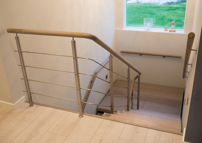 Stairs from oak and railings from stainless steel stripes.