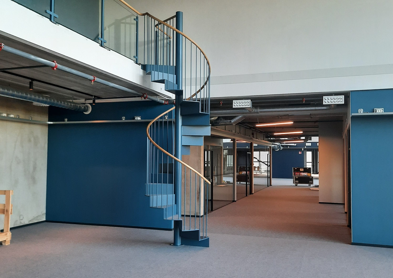 Tiny staircase just from steel and oak handrail for an office in Sweden.