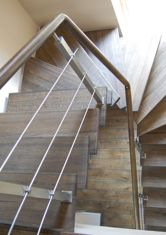 U-shape staircase with dark-brown oak steps.