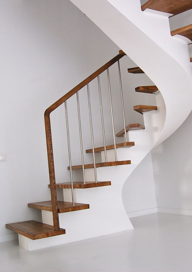 Staircase with white painted steel construction and oak steps.