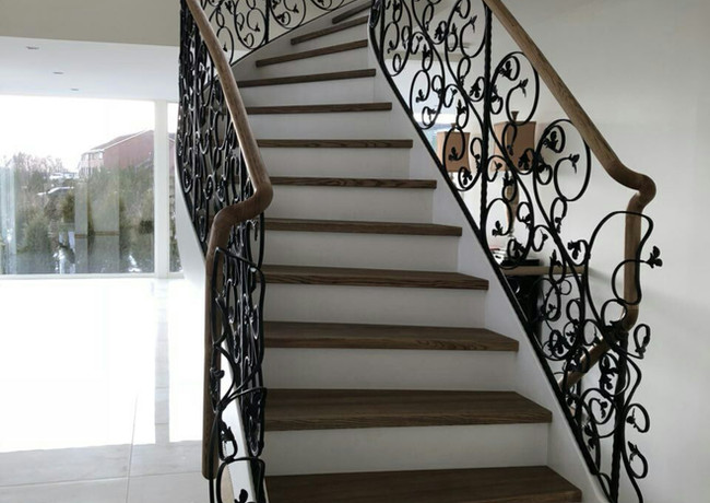 Solid steel L-shape construction with custom blacksmith railings.