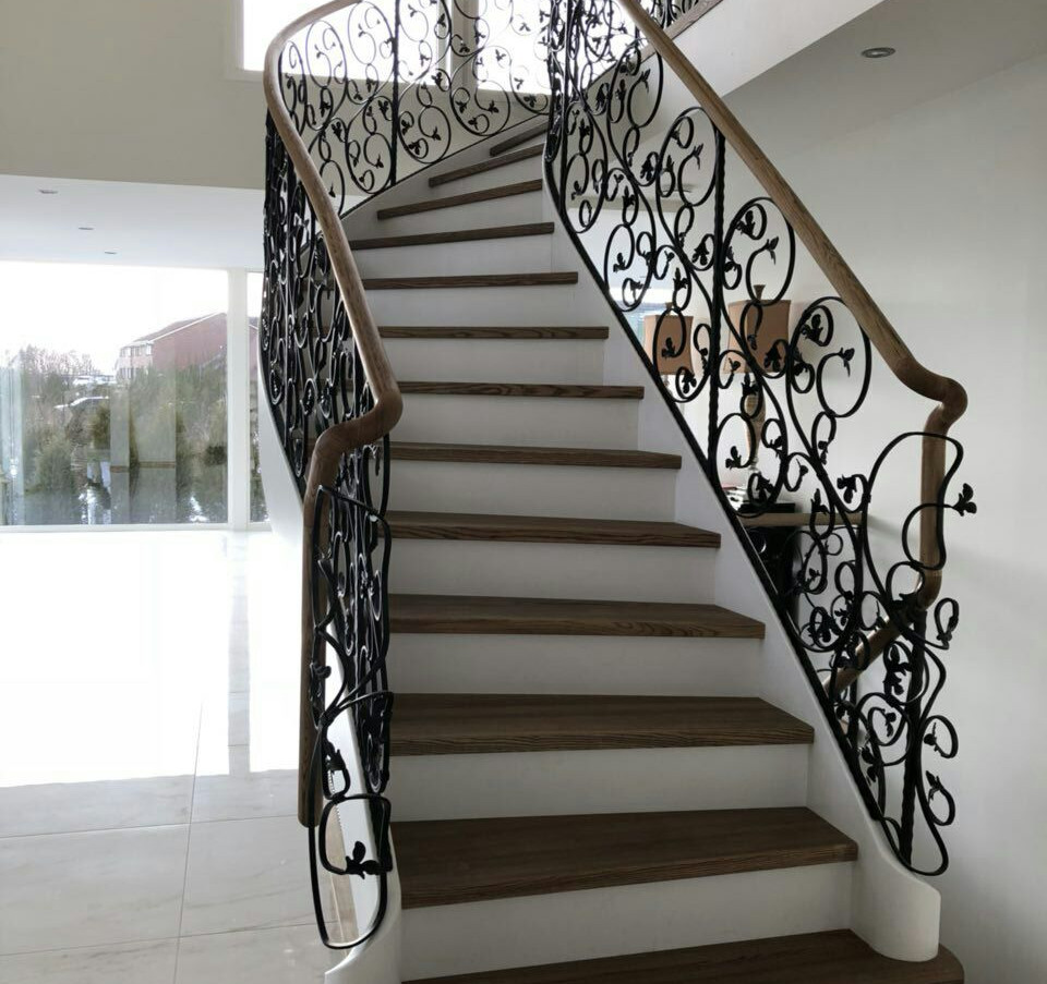Solid steel L-shape construction with custom blacksmith railings.
