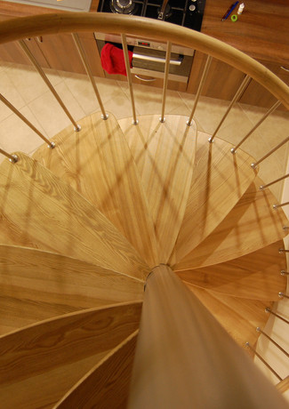 U-shape staircase from above with open stairs from oak.