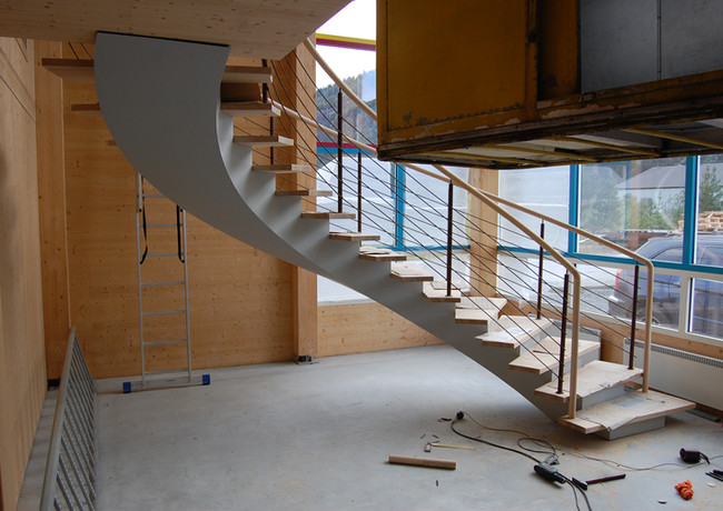 Blended steel construction staircase with thin steps from oak.