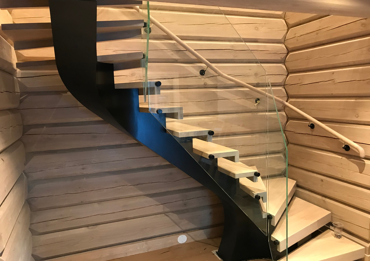 Stairs with black steel constructio, glass railings and oak steps.