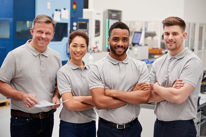 Portrait Of Engineering Team On Factory