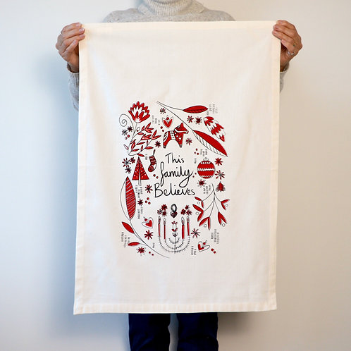 'This family believes' Tea towel
